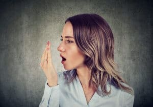 A woman having bad breath