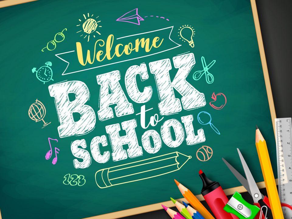 The words welcome back to school written on a chalkboard