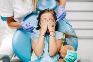 child afraid of a dentist