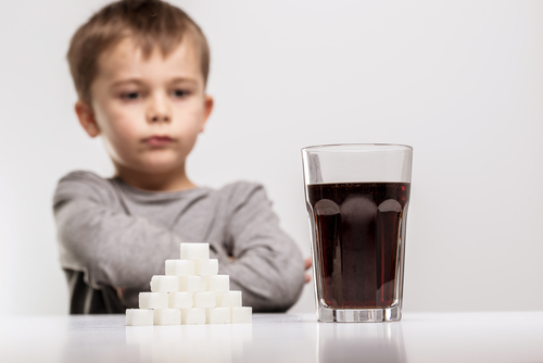 A child looking at the sugar contents of soda