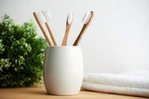 a group of toothbrushes in a holder