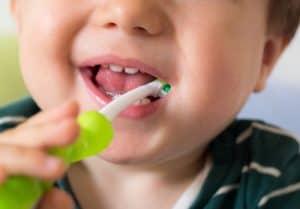 a baby brushing his teeth